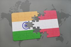 Puzzle with the national flag of india and austria on a world map background. 3D illustration Stock Photography