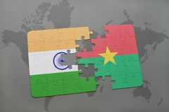 Puzzle with the national flag of india and burkina faso on a world map background. 3D illustration stock photo