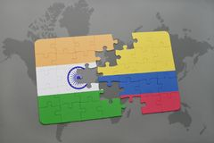 Puzzle with the national flag of india and colombia on a world map background. 3D illustration stock photo