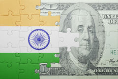 Puzzle with the national flag of india and dollar banknote Stock Photos
