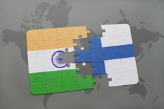 Puzzle with the national flag of india and finland on a world map background. Royalty Free Stock Image