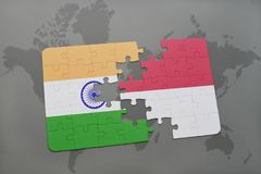 Puzzle with the national flag of india and indonesia on a world map background. 3D illustration Royalty Free Stock Images