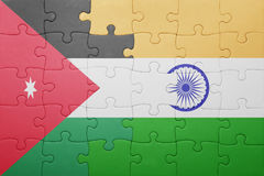 Puzzle with the national flag of india and jordan Royalty Free Stock Photos