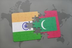 Puzzle with the national flag of india and maldives on a world map background. Royalty Free Stock Images