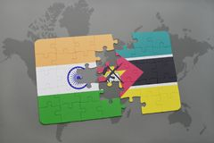 Puzzle with the national flag of india and mozambique on a world map background. 3D illustration stock photo