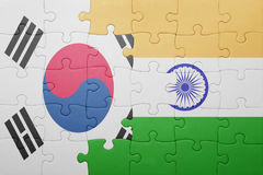 Puzzle with the national flag of india and south korea. Concept stock photos