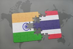 puzzle with the national flag of india and thailand on a world map background. Stock Images