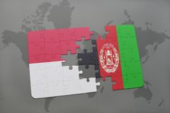 Puzzle with the national flag of indonesia and afghanistan on a world map background. 3D illustration Royalty Free Stock Image