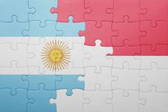 Puzzle with the national flag of indonesia and argentina Royalty Free Stock Images