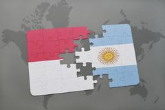 Puzzle with the national flag of indonesia and argentina on a world map background. Stock Images