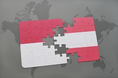 Puzzle with the national flag of indonesia and austria on a world map background. 3D illustration Stock Image