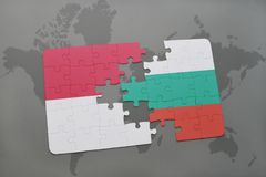 Puzzle with the national flag of indonesia and bulgaria on a world map background. 3D illustration Royalty Free Stock Image