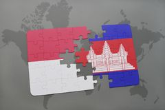 Puzzle with the national flag of indonesia and cambodia on a world map background. 3D illustration Royalty Free Stock Image