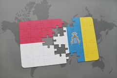 Puzzle with the national flag of indonesia and canary islands on a world map background. 3D illustration Stock Image