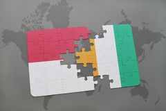 Puzzle with the national flag of indonesia and cote divoire on a world map background. 3D illustration Royalty Free Stock Image