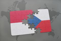 Puzzle with the national flag of indonesia and czech republic on a world map background. 3D illustration Royalty Free Stock Photography
