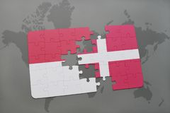 Puzzle with the national flag of indonesia and denmark on a world map background. 3D illustration Royalty Free Stock Images