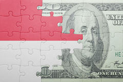 Puzzle with the national flag of indonesia and dollar banknote Royalty Free Stock Image