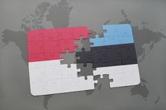 Puzzle with the national flag of indonesia and estonia on a world map background. 3D illustration Stock Photos
