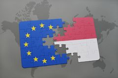 Puzzle with the national flag of indonesia and european union on a world map. Background stock photos