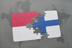 Puzzle with the national flag of indonesia and finland on a world map background. 3D illustration Royalty Free Stock Image