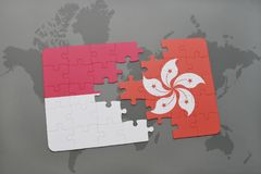 Puzzle with the national flag of indonesia and hong kong on a world map background. 3D illustration Royalty Free Stock Images