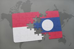 Puzzle with the national flag of indonesia and laos on a world map background. 3D illustration Royalty Free Stock Photography