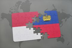 Puzzle with the national flag of indonesia and liechtenstein on a world map background. Royalty Free Stock Photography