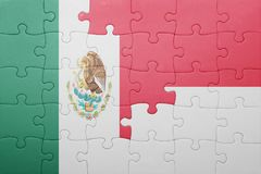Puzzle with the national flag of indonesia and mexico. Concept stock image