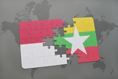 Puzzle with the national flag of indonesia and myanmar on a world map background. 3D illustration Stock Photos