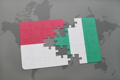 Puzzle with the national flag of indonesia and nigeria on a world map background. Royalty Free Stock Photos