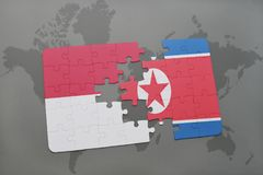 Puzzle with the national flag of indonesia and north korea on a world map background. 3D illustration Royalty Free Stock Image