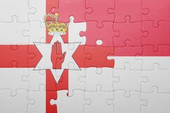 Puzzle with the national flag of indonesia and northern ireland Stock Photo