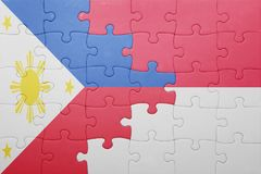 Puzzle with the national flag of indonesia and philippines. Concept royalty free stock photography