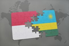 Puzzle with the national flag of indonesia and rwanda on a world map background. 3D illustration Stock Photography