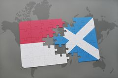 Puzzle with the national flag of indonesia and scotland on a world map background. 3D illustration Royalty Free Stock Photos