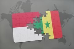Puzzle with the national flag of indonesia and senegal on a world map background. 3D illustration Stock Photo