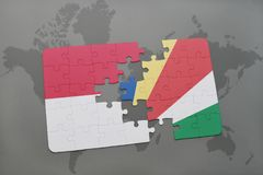 Puzzle with the national flag of indonesia and seychelles on a world map background. 3D illustration Stock Images