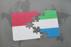 Puzzle with the national flag of indonesia and sierra leone on a world map background. 3D illustration Royalty Free Stock Photos