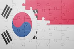 Puzzle with the national flag of indonesia and south korea. Concept royalty free stock image
