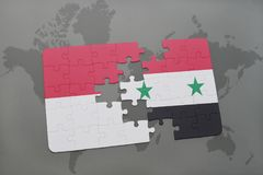 Puzzle with the national flag of indonesia and syria on a world map background. 3D illustration Stock Photo