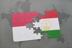 Puzzle with the national flag of indonesia and tajikistan on a world map background. 3D illustration Stock Photography