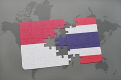 Puzzle with the national flag of indonesia and thailand on a world map background. 3D illustration Royalty Free Stock Photos