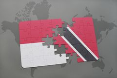 Puzzle with the national flag of indonesia and trinidad and tobago on a world map background. 3D illustration Stock Images