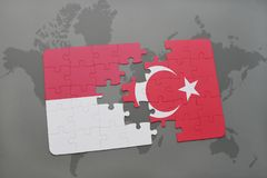 Puzzle with the national flag of indonesia and turkey on a world map background. 3D illustration Stock Photography