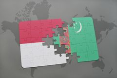 Puzzle with the national flag of indonesia and turkmenistan on a world map background. 3D illustration Royalty Free Stock Photography