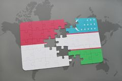Puzzle with the national flag of indonesia and uzbekistan on a world map background. 3D illustration Royalty Free Stock Photos