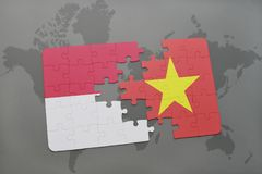 Puzzle with the national flag of indonesia and vietnam on a world map background. 3D illustration Stock Image