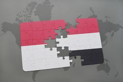 Puzzle with the national flag of indonesia and yemen on a world map background. 3D illustration Royalty Free Stock Images
