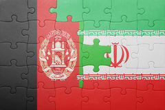 Puzzle with the national flag of iran and afghanistan Royalty Free Stock Images